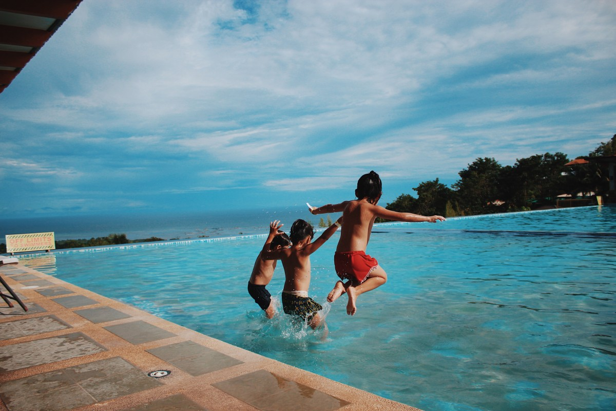 Three-boy-s-jumping-into-the-water-870170-2